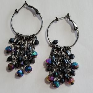Hoop earing with hanging oil colored beads